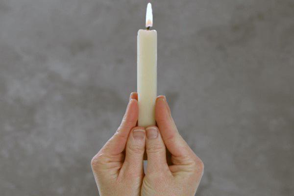 simpatia da vela lambida